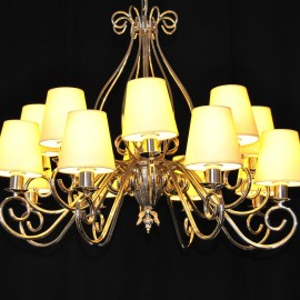The custom-made silver tubular chandelier with white lampshades