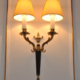 Various wall lights made of cast brass